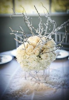Stunning winter wedding centerpiece!  branches covered w/ hot glue and glitter