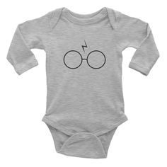 This long-sleeve baby onesie is soft, comfortable, and made of 100% cotton. It's designed to fit infants of all sizes, with a rib knit to give good stretch and a neckband for easy on-and-off. • 100% b