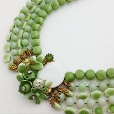 Check out this item in my Etsy shop https://www.etsy.com/listing/255472462/beaded-clasp-multi-strand-green-necklace