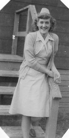 Elna Jones in Army Nurse Corps brown and white seersucker hospital uniform and cap at Camp Kilmer, New Jersey, circa 1946. She joined the Cadet Nurse Corps in 1944 and the Army Nurse Corps in 1945 ~