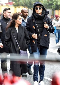 Well wrapped: On a chilly day in the French capital Ronaldo stayed warm in a thick roll ne...