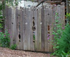 Fence with decorative cutouts and fancy top. Can you say fresh ...
