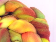 This listing is for 3.9 ounces of hand dyed 19 micron Merino combed top.   I dye my fibers with professional grade acid dyes and do my best to exhaust and rinse any excess dye.  Pictures are taken of the front and back of fiber braid, as well as a close up section. While I do everything I can to represent my colors as close to the original as they appear, please be advised that different monitors can have an affect on how colors are read.
