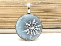winter blue snowflake necklace on repurposed coin by resonates