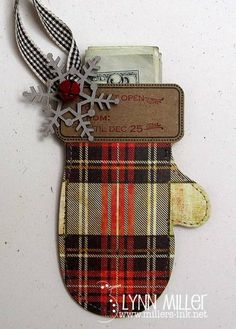 this will hold my nephew, kreighton's xmas money this year.  I tried to keep it simple for him.  love this plaid paper from basic grey-jovial.  I stitched together  two mittens, stamped the cuff, added a snowflake by melissa frances and a red bell from hobby lobby.  the ribbon is mays road.  thanks for looking:) http://www.millers-ink.net/2010/11/ninas-mitten.html
