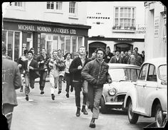 """city-runners: """" Skinheads running through the streets of Brighton chanting on support of their football team Chelsea. March 1970 By Bill Cross (Daily Mail / Rex Features) """" Brighton Lanes, Brighton Rock, Brighton And Hove, Brighton Events, Skinhead Boots, Skinhead Fashion, Football Firms, Football Team, Football Casuals"""