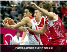 207a: The athletes are shown in full action, the Chinese player seeming to have the advantage: he is in the forefront with his back turned to both opponents, who are struggling to take the ball from him. The audience is blurred, and even the opponent on the right side in order to have all the focus and attention on the Chinese player.