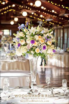 Centerpiece for a Wedding Reception at Biltmore Estate's Deerpark Restaurant venue. A beautiful September wedding featuring flowers by Flower Gallery of Asheville  #wedding #flowers #centerpiece