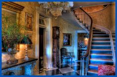 The Plantation House, circa 1840.  Brian, Stacie, and London Keller.   Foyer with original spiral staircase, rosewood banister. Design and hand painted faux marbleized walls by Stacie Webb-Keller. Black and white painted harlequin diamonds on hardwood.