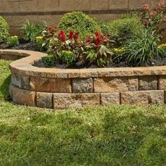 Pavestone RockWall Yukon Medium Concrete Garden Wall Block Cap creates a natural look to your yard and garden. Landscaping Shrubs, Landscaping Retaining Walls, Small Backyard Landscaping, Landscaping With Rocks, Backyard Ideas, Landscaping Blocks, Corner Landscaping Ideas, Sidewalk Landscaping, Landscaping Costs