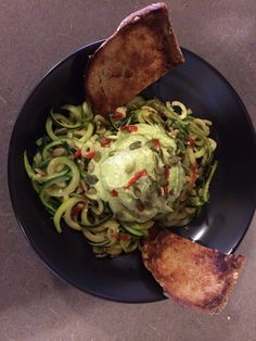 Spiralized zucchini with avocado  Alfredo sauce.  I made this! 15 min. Losing weight a bonus.  Never hungry.  Vegan. You'd pay to eat this.  Just sayin.
