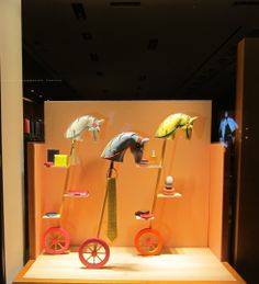 Window Display the stick horses are cheap and easy to make - for window display artists, cheap and easy is always a benefit - and if your client is paying for props, they love the savings!