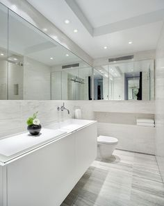 bathroom ideas   Ensuite idea... Simple, sleak white bathroom. Love the wrap around mirror and recessed shelf.