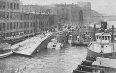 View of S.S. Eastland taken from Fire Tug in the Chicago River on July 24, 1915 as it was docked at the Clark St. Bridge. The ship rolled killing approximately 844 people.