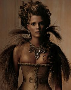 Quite a nice pic for Queenie - some elements of wild (feathers) and some of burlesque (corset)