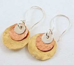 These earrings were worn by Bonnie Bedelia's character Camille on Parenthood in Episode 507.  I handcrafted these earrings using copper, brass and sterling silver disks. The copper and brass disks hav