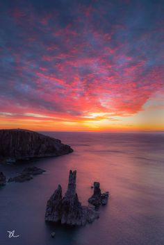Red Mangersta Crofts - The photo was taken at Mangersta on the Isle of Lewis (Outer Hebrides, Scotland) one evening of last week with this amazing sunset and cloudscape (we were so lucky !).  Mangersta crofts - Lewis Isle - Outer Hebrides- Scotland)