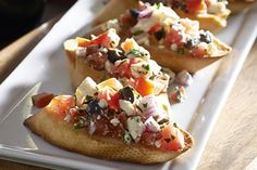 Turn a French baguette and a few other ingredients like plum tomatoes, black olives and red onions into Tomato-Basil Bruschetta with Feta. Our tomato basil bruschetta is 'betta' with feta. Kraft Foods, Kraft Recipes, Potluck Recipes, Ww Recipes, Appetizer Recipes, Cooking Recipes, Cooking Time, Cheese Recipes, Recipies