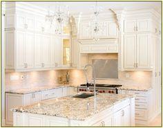Delicatus White Granite Countertop with White Kitchen Cabinets
