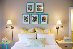 Spray paint picture frames in a bright color to hang on a neutral wall.