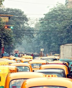 A sea of yellow taxi cab roofs in Calcutta The Places Youll Go, Places To Visit, Mother India, Taj Mahal, Amazing India, Polaroid, North India, West Bengal, Mellow Yellow