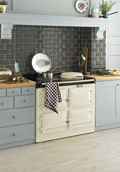 Kitchen wall tiles are perfect to add character to your cooking space. Whether it's a feature splashback or a simple border, there is something for everyone in our collection of kitchen wall tiles. Gray Kitchen Backsplash, Blue Kitchen Tiles, Aga Kitchen, Kitchen Colors, Country Kitchen, Kitchen Design, Kitchen Decor, Kitchen Counters, Kitchen Ideas
