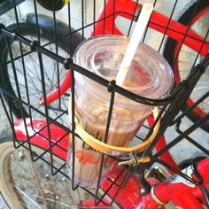 Embroidery hoop becomes bike basket cup holder attachment.