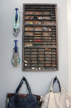 An old printing press drawer makes the perfect jewelry organizer