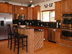 Gourmet Kitchen - granite countertops and stainless steel appliances