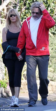 """February 25, 2013    """"Death Becomes Her"""" star Goldie Hawn enjoys a Monday morning walk with her partner Kurt Russell in Pacific Palisades, California."""