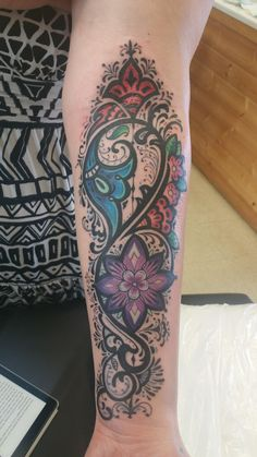 paisley and henna inspired floral forearm piece, by Leilani Ka'ohunani Yates at South Seas Tattoo in Hilo, Hawaii