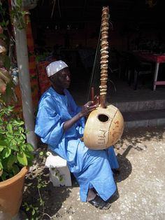 Africa |  Sights and Sounds.  Kora player in Lac Rose (Pink Lake) close to Dakar in Senegal.