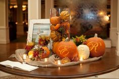 Interesting idea for your reception...different guest book ideas to come...(Monogrammed pumpkins from rusticweddingchic.com)