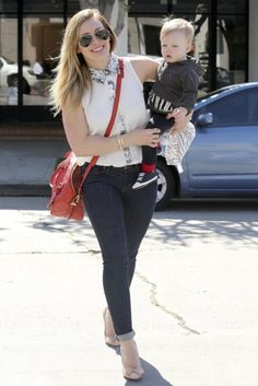 Hilary Duff carries a red diaper bag for all her baby needs