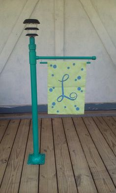 Campsite flag holder made from pvc pipe. Girls can make from wood for LM?