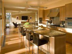 A cozinha americana é uma maneira de deixar o ambiente funcional, organizado e bonito. Clique na imagem e saiba como ter uma na sua casa.