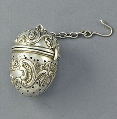 Antique sterling silver teaball - the ornate styling is Rococco decoration. Circa 1900.
