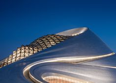 MAD-designed opera house features an undulating form that wraps two concert halls and a huge public plaza
