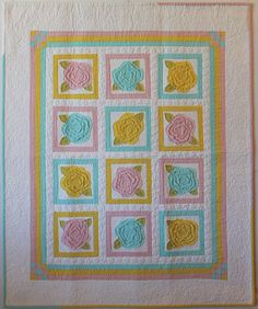 """Christa's Quilts - Roses for Katelyn made quilt for a niece. Christa used French Rose Buds pattern and tweaked the design slightly.The solid pastels against the snowy white background make a sugary sweet quilt perfect for a baby girl! Finished size: 35"""" x 42"""" inches Christa provides links for you to view process posts with detailed photos. http://christaquilts.com/christas-quilts-roses-for-katelyn/"""