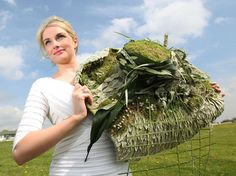 Charlotte Wood from Leicester, models a fifty shades of green hat made from flowers and foliage, as the Harrogate Spring Flower show prepares for Britain's biggest display of floral art at Great Yorkshire Showground, Harrogate, on April 23, 2014. (Photo by Lynne Cameron/PA Wire)