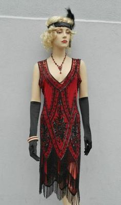"This dress was made for the Charleston, the 7″ long beaded fringe cascades down 3 tiers to provide constant motion. The style of the dress is non fitted with a dropped waist, the concept of the dress is simple, but the beadwork is the real ""wow' factor in the dress. The sequins and beads decorate the dress in an ornate floral pattern, even though the dress is heavily beaded; it is still easy to move in an fun to wear. If you want to be the belle of the ball, this is your dress."