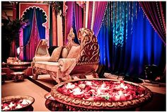 love the seating and rose petals in water basins for this mandap