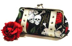 bones/skulls hand made rockabilly style clutch off of Etsy, of course!!