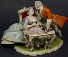 ERNST WAHLISS PORCELAIN GROUP OF MAN & WOMAN Antique Ernst Wahliss German porcelain group figure. Depicts a man and woman with a small dog. She is sewing while the man is talking to her.