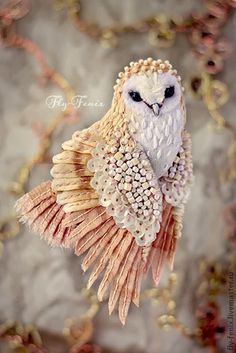 My Owl Barn: Julia Gorina: Miniature Textile Brooches. Russian artist Julia Gorina hand makes these miniature birds and owls brooches using vintage fabric and laces that are hand painted and meticulously embroidered. I am in awe at the painstaking detail in each piece.