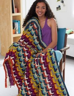 Can't get enough color in your life? The Hooked on Color afghan has twelve colors that will brighten anyone's day. With a unique hook design, this geometric free crochet pattern has a mod chic look.