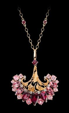 NECKLACE GENUS - YELLOW GOLD 18KT, DIAMONDS AND TOPAZ