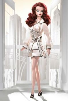 Suite Retreat™ Barbie® Doll | The Barbie Collection.Designer: Robert Best Release Date: 2/15/2005Suite Retreat™ Barbie® doll is a sophisticated siren who oozes glamour and luxury. This sultry redhead wears a charmeuse pajama jacket with faux pearl buttons and blousy, chiffon sleeves. Her matching tap pants are trimmed in black and made of the same luscious cream. She completes the loungewear look with high-heeled black sandals and faux pearl-drop earrings.