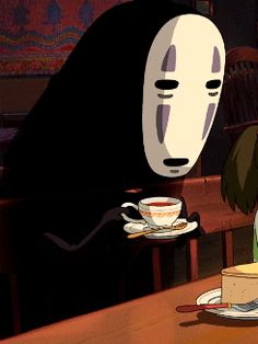 whisper-s-of-the-heart:  No Face drinking tea and eating cake - Spirited Away. I can't help but think this is adorable