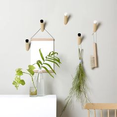 Simple modern entryway hooks for coats, scarves and bags. Entryway Hooks, Pine Shelves, Super Strong Magnets, Interior Sliding Barn Doors, Modern Entryway, Shop Interiors, Modern Spaces, Hanging Art, Wall Hooks